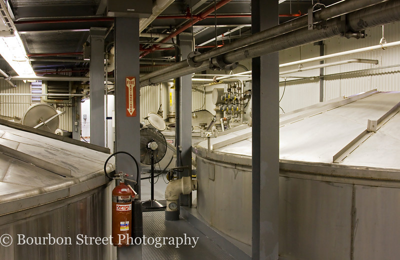The fermenter room.  In these tanks the yeast is added to cooked mash to convert sugars into alcohol.  A single strain of yeast is used for all their whiskey.  Heaven Hill contracts an outside firm to culture their proprietary yeast strain and deliver it back to them in dry form.