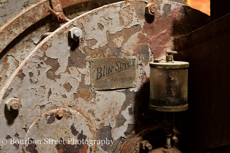 Manufacturers plate on the hammer mill. A 'Blue Streak' Pulverizer, manufactured by Prater Pulverizer Company, Chicago IL.