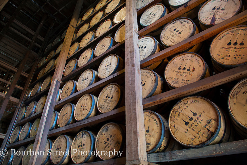 Barrels aging in the limestone warehouses