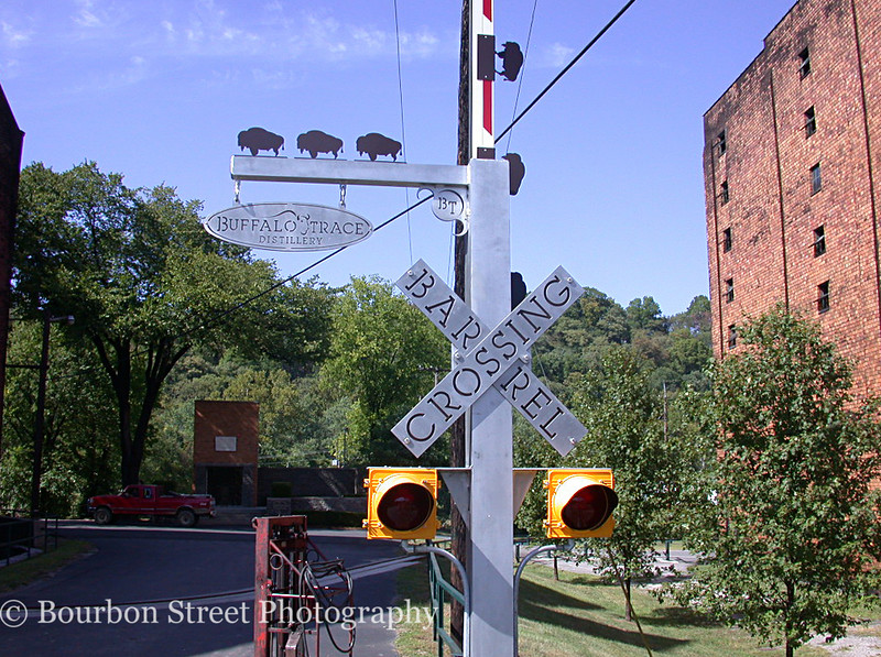 The new barrel-crossing gate.  There is a set of metal rails across this road for rolling barrels between buildings.  <br /> <br /> In their typical playful style, Buffalo trace installed this stylized crossing gate.