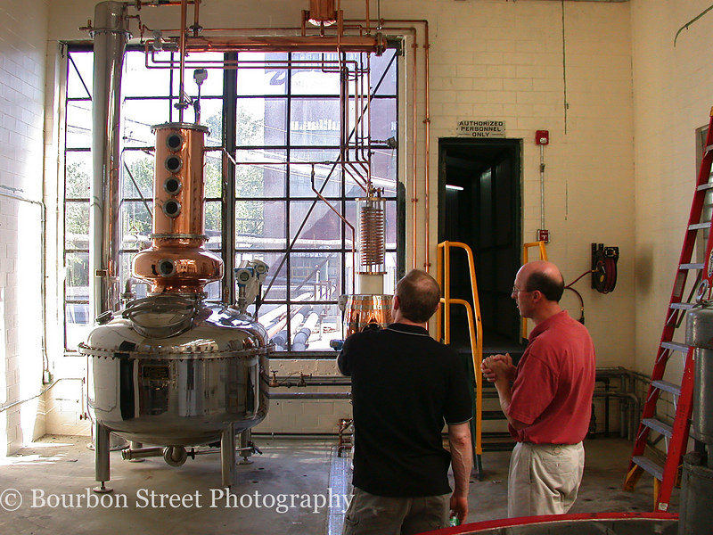Buffalo Traces 'micro-still'.  <br /> <br /> They use this still for doing small scale experimental distillations and hope to offer a custom contract distillation program for the bourbon enthusiast who wants to craft their own batch.  <br /> <br /> Arthur Lyman on left, Mark Brown on right.