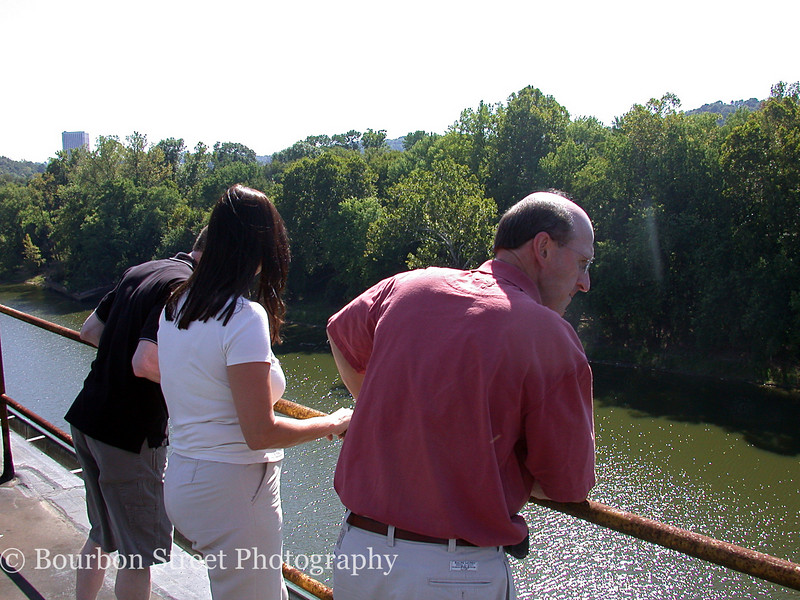 View of the Kentucky River from the roof of the distillery.  <br /> <br /> From left to right:  Art Lyman (Bourbon connoisseur), Meredith Moody (Marketing Services Director, Buffalo Trace), and Mark Brown (President / CEO, Buffalo Trace)  <br /> <br /> Mark told us the distillery was thinking of creating a public park along the banks of the river below.  It would be a wonderful location, but I think they dropped the idea since it would probably wash away each spring when the river rises.