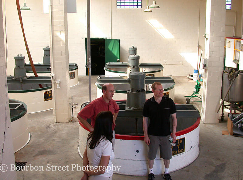 These are the yeast tubs where yeast is grown and prepared for fermentation.  They could also be used as mash tubs for small experimental batches.  Left to right:  Meredith Moody, Mark Brown, Arthur Lyman.
