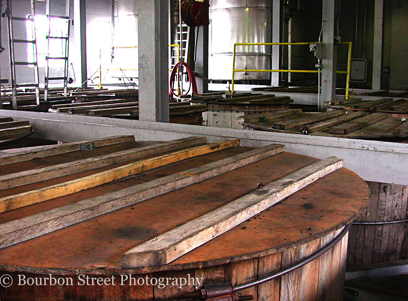 Jack Daniel's whiskey is 'charcoal mellowed' by letting it drip through 10 feet of maple charcoal.  This is what distinguishes Tennessee Whiskey from other American Whiskeys such as Bourbon.  <br /> <br /> These covered wooden tanks are filled with charcoal.  Freshly distilled whiskey drips in at the top and is collected at the bottom.  The filtered whiskey is then ready to be barreled and aged.