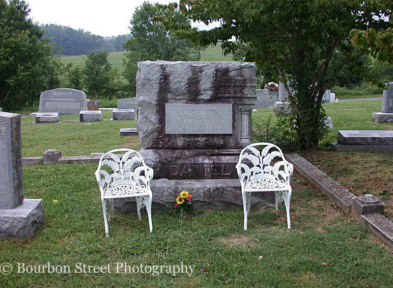 Jack Daniel's gravesite. Jack died in 1911 and no one's quite sure of the exact date of his birth. <br /> <br /> It's said that the chairs were placed there to comfort the many local ladies who mourned his passing.
