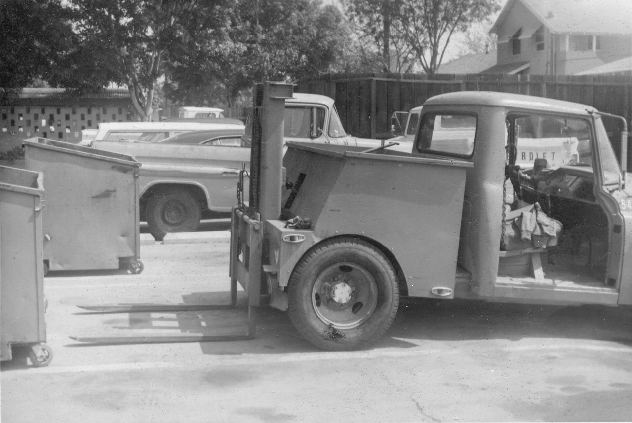 Lowe Disposal Chevrolet Bowles Container Delivery Truck