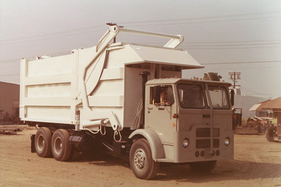 71 White Compact Bowles Front Load Roll Off