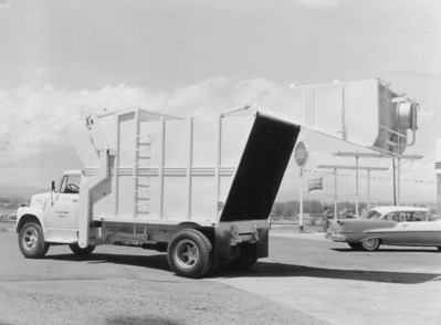 Because of the unusual design of the tailgate and body (bisected at an angle), the blade does not travel the entire length of the body; it was only necessary that it reach the rear edge of the floor to unload. Any refuse trapped in the tailgate would fall out when it was hydraulically raised. This was an ingenious way of shortening the length of the cylinders needed to eject the load. Capacity was 25 cubic yards.