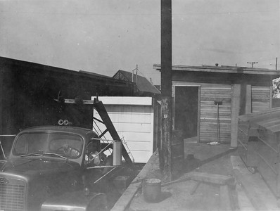 Early 60's Reo Unloading 22' Box Next To A Dock