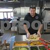 Krish Shah makes a burrito Friday, March 10, at Bowlrrito Fresh Grill, 1180 W. Lincoln Highway in DeKalb.