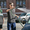 St. Leo's of Leominster Boy Scout Troop 11 held a car wash on Saturday, August 24, 2019 in the parking lot of St. Leo's. Boy Scout Patrick Conlan, 16, sprays down one of the cars after it was washed at the fundraiser. SENTINEL & ENTERPRISE/JOHN LOVE