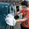 St. Leo's of Leominster Boy Scout Troop 11 held a car wash on Saturday, August 24, 2019 in the parking lot of St. Leo's. Boy Scout Aaron Moua, 10, helps wash one  of the cars at the fundraiser. SENTINEL & ENTERPRISE/JOHN LOVE