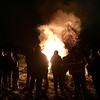 Impressed by the size, the crowd stays back and watches the bonfire burn. Photo by Mary Leach