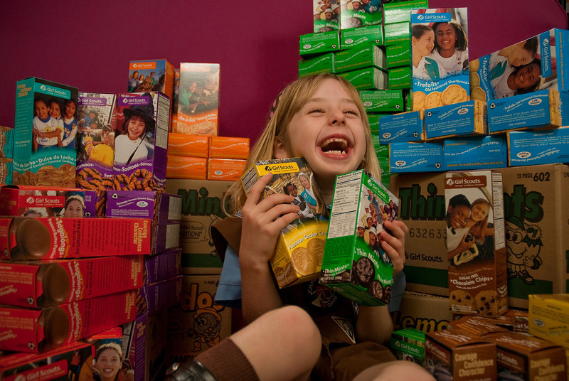 """REDONDO BEACH , CALIFORNIA Ñ Annette poses with the 110 Girl Scout cookie boxes she sold in her first year as a Brownie. The """"studio"""" was in the Sorensen living room. Photo by Tom Sorensen Saturday February 28th, 2009."""