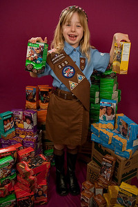"""REDONDO BEACH , CALIFORNIA — Annette poses with the 110 Girl Scout cookie boxes she sold in her first year as a Brownie. The """"studio"""" was in the Sorensen living room. Photo by Tom Sorensen Saturday February 28th, 2009."""