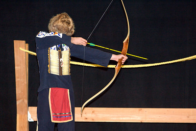 A Boy Scout archer shot the ceremonial arrow for each boy crossing from Cub Scouts to Boy Scouts.