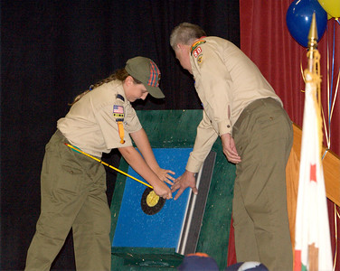 David receives his first official aid from Scout Master Duane Anderson who came to welcome him to Troop 80.