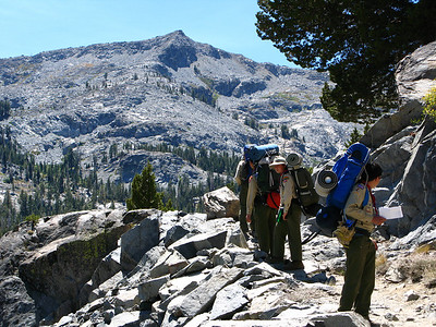 "As we climbed, the surrounding terrain certainly deserved the name ""Desolation Wilderness"", even though we weren't technically in the Wilderness yet.  Fortunately we didn't really have to spend a lot of time in the exposed, rocky part of the Wilderness, as you'll see."