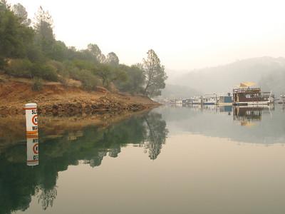 Beautiful calm water, but smokey skies.