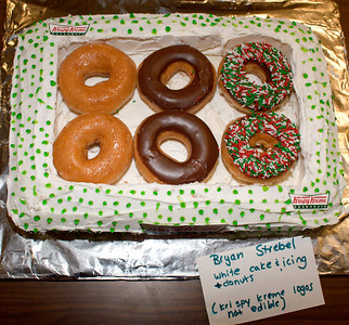 Who doesn't like a box of Krispy Kremes?  And if that box is made of cake...