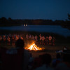 Camp fire with Order of the Arrow members crossing Lake Bastrop