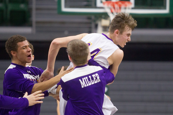 Record-Eagle/Brett A. Sommers Frankfort's Will Newbold celebrates winning Thursday's Division 4 state semifinal boys basketball game against Tri-unity Christian at the Breslin Center in East Lansing.