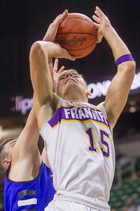 Record-Eagle/Brett A. Sommers Frankfort's Conner Smith has his shot blocked from behind during Thursday's Division 4 state semifinal boys basketball game against Tri-unity Christian at the Breslin Center in East Lansing.