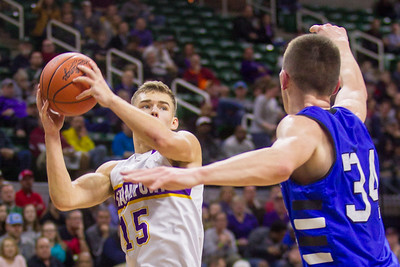 Record-Eagle/Brett A. Sommers Frankfort's Conner Smith pump fakes a defender during Thursday's Division 4 state semifinal boys basketball game against Tri-unity Christian at the Breslin Center in East Lansing.
