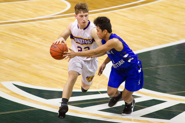 Record-Eagle/Brett A. Sommers Frankfort's Ethan Ness dibbles the ball during Thursday's Division 4 state semifinal boys basketball game against Tri-unity Christian at the Breslin Center in East Lansing.