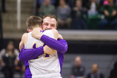 Record-Eagle/Brett A. Sommers Frankfort assistant coach David Loney embraces Will Newbold after winning Thursday's Division 4 state semifinal game at the Breslin Center in East Lansing. Frankfort won 44-43.