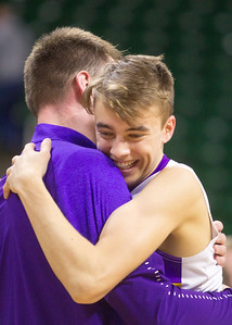 Record-Eagle/Brett A. Sommers Frankfort's Luke Hammon (right) embraces coach Dan Loney after winning Thursday's Division 4 state semifinal game at the Breslin Center in East Lansing. Frankfort won 44-43.