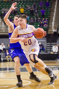 Record-Eagle/Brett A. Sommers Frankfort's Jack Reznich dribbles around a defender during Thursday's Division 4 state semifinal boys basketball game against Tri-unity Christian at the Breslin Center in East Lansing.