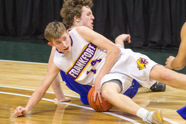 Record-Eagle/Brett A. Sommers Frankfort's Will Newbld fights for a loose ball during Thursday's Division 4 state semifinal boys basketball game against Tri-unity Christian at the Breslin Center in East Lansing.