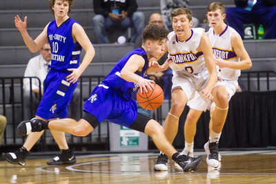 Record-Eagle/Brett A. Sommers Tri-unity Christian's Ophoff attacks Frankfort's Jack Stefanski off the dribble during Thursday's Division 4 state semifinal boys basketball game at the Breslin Center in East Lansing.