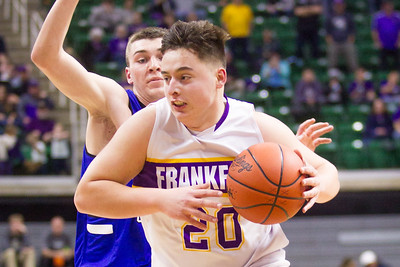 Record-Eagle/Brett A. Sommers Frankfort's Jack Reznich beats his defender off the dribble during Thursday's Division 4 state semifinal boys basketball game against Tri-unity Christian at the Breslin Center in East Lansing.