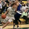 Oakmont Regional High School boys basketball played Leominster High School on Wednesday night, Feb. 5, 2020 in Ashburnham. ORHS's #11 Jaylen Kirkland and LHS's #4 Jeramiah Paulino.  SENTINEL & ENTERPRISE/JOHN LOVE