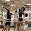 Oakmont Regional High School boys basketball played Leominster High School on Wednesday night, Feb. 5, 2020 in Ashburnham. LHS's #11 Liam Connacher and #12 Brain Perez go up for a rebound with ORHS's #23 Matt Arcangeli. SENTINEL & ENTERPRISE/JOHN LOVE