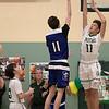 Oakmont Regional High School boys basketball played Leominster High School on Wednesday night, Feb. 5, 2020 in Ashburnham. ORHS's #11 Jaylen Kirkland tries to stop a shot by LHS's #11 Liam Connacher. SENTINEL & ENTERPRISE/JOHN LOVE