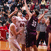 STAN HUDY - SHUDY@DIGITALFIRSTMEDIA.COM<br /> Mechanicville junior Jack Phelan (24) watches his shot as he was challenged by Stillwater's Brian McNeil under the basket with teammate Joey Germain (left) nearby Tuesday night in Wasaren League action.