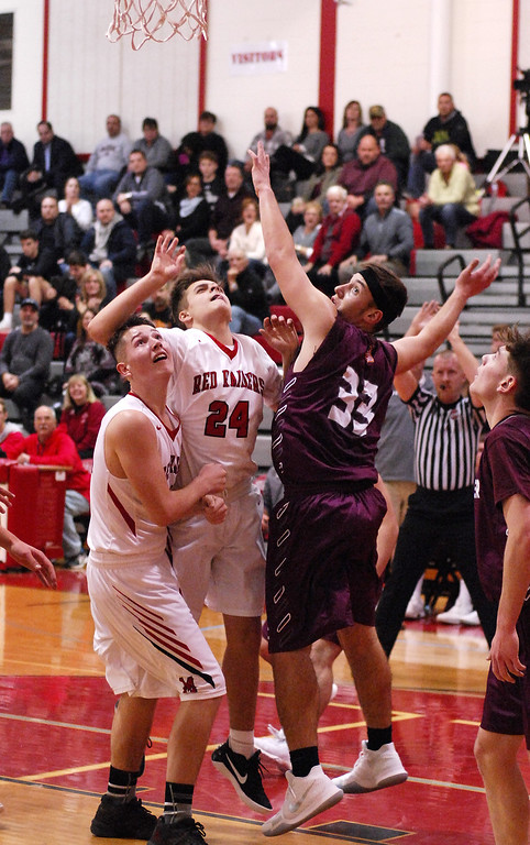 . STAN HUDY - SHUDY@DIGITALFIRSTMEDIA.COMMechanicville junior Jack Phelan (24) watches his shot as he was challenged by Stillwater\'s Brian McNeil under the basket with teammate Joey Germain (left) nearby Tuesday night in Wasaren League action.
