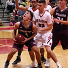 STAN HUDY - SHUDY@DIGITALFIRSTMEDIA.COM<br /> Stillwater junior Scott Travis looks to go up under the basket in front of Mechanicville's Luciano D'Ambro (23) and Chris Sullivan (back) Tuesday night in Wasaren League action.
