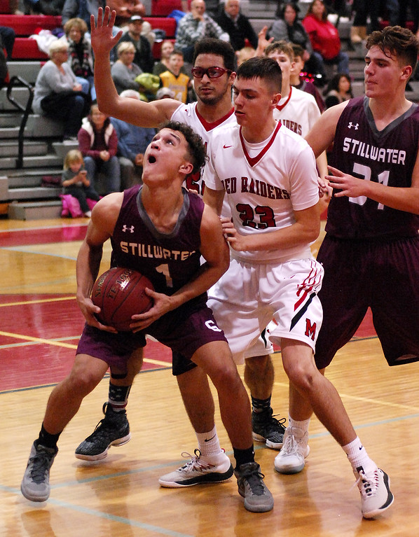 . STAN HUDY - SHUDY@DIGITALFIRSTMEDIA.COMStillwater junior Scott Travis looks to go up under the basket in front of Mechanicville\'s Luciano D\'Ambro (23) and Chris Sullivan (back) Tuesday night in Wasaren League action.