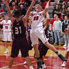 STAN HUDY - SHUDY@DIGITALFIRSTMEDIA.COM<br /> Mechanicville senior Joey Germain (20) puts up a shot in the lane, challenged by Stillwater's James Galarneau (31) late Tuesday night in Wasaren League action.