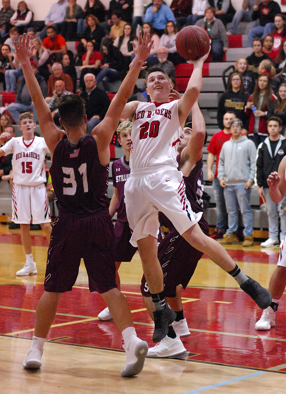 . STAN HUDY - SHUDY@DIGITALFIRSTMEDIA.COMMechanicville senior Joey Germain (20) puts up a shot in the lane, challenged by Stillwater\'s James Galarneau (31) late Tuesday night in Wasaren League action.