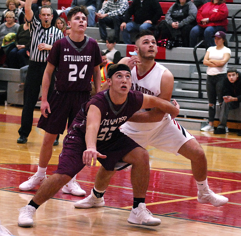 . STAN HUDY - SHUDY@DIGITALFIRSTMEDIA.COMStillwater sophomore Brian McNeil looks to block out Mechanicville\'s Nick Billert Tuesday night in Wasaren League action.