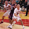 STAN HUDY - SHUDY@DIGITALFIRSTMEDIA.COM<br /> Stillwater sophomore James Galarneau battles both Mechanicville's Luciano D'Ambro (23) and Peter Enzien (13) under the basket Tuesday night in Wasaren League action.