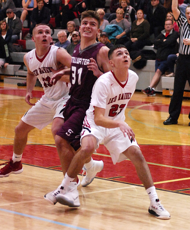 . STAN HUDY - SHUDY@DIGITALFIRSTMEDIA.COMStillwater sophomore James Galarneau battles both Mechanicville\'s Luciano D\'Ambro (23) and Peter Enzien (13) under the basket Tuesday night in Wasaren League action.