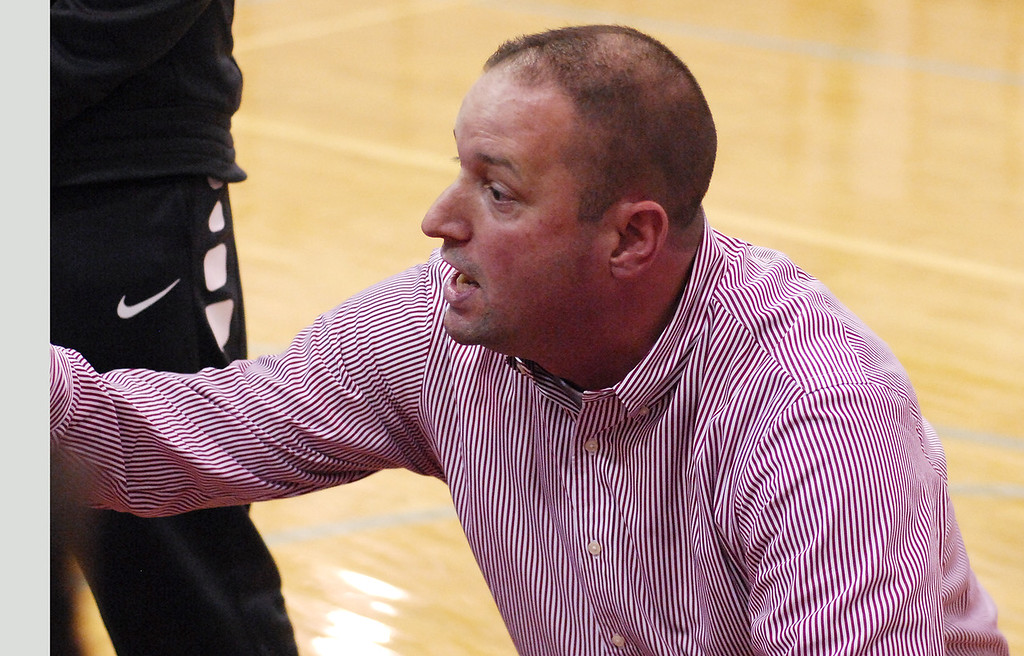 . STAN HUDY - SHUDY@DIGITALFIRSTMEDIA.COMMechanicville Coach Rian Richardson talks to his Red Raiders bench during a time out Tuesday night during Wasaren League action against rival Stillwater.