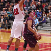 STAN HUDY - SHUDY@DIGITALFIRSTMEDIA.COM<br /> Stillwater sophomore Brian McNeil looks to drive the lane under a leaping Mechanicville senior Chris Sullivan (22) Tuesday night in Wasaren League action.