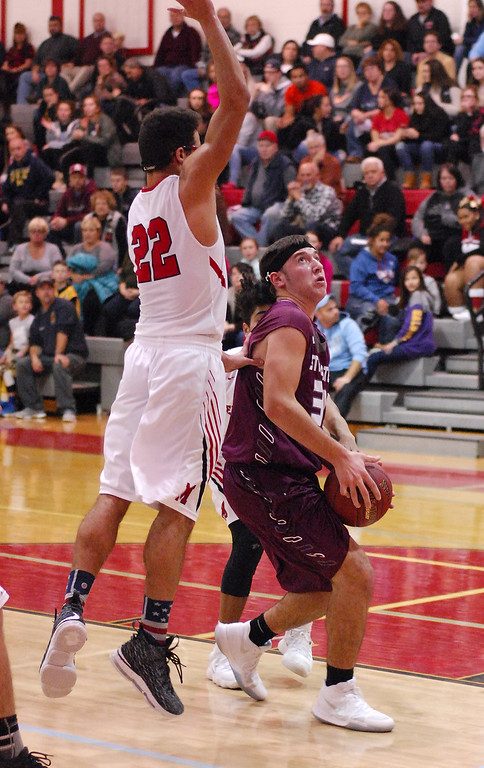 . STAN HUDY - SHUDY@DIGITALFIRSTMEDIA.COMStillwater sophomore Brian McNeil looks to drive the lane under a leaping Mechanicville senior Chris Sullivan (22) Tuesday night in Wasaren League action.